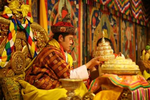 "His Majesty Jigme Khesar Namgyel Wangchuck, King of Bhutan receives the ""Mendrey"" (religious offering) during the Coronation ceremony in the Throne Room. (IPTC embedded)"